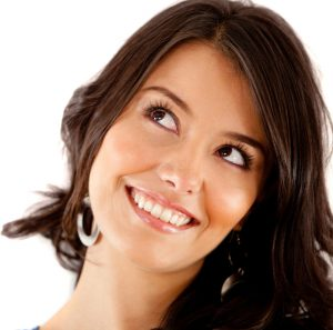 brunette woman smiling and looking up at the ceiling
